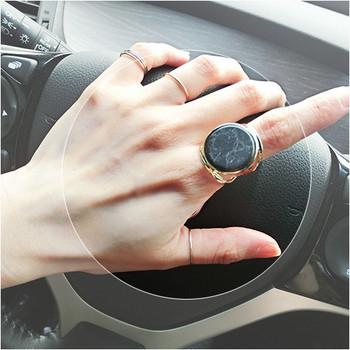 Дамски пръстен в бял и черен цвят с мраморен ефект