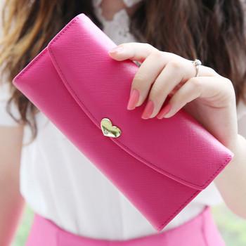 Γυναικείο πορτοφόλι με μεταλλική διακόσμηση σε δύο χρώματα