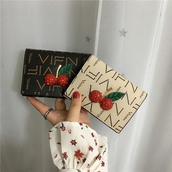 Γυναικείο  μοντέρνο πορτοφόλι με τρισδιάστατο στοιχείο σε τρία χρώματα