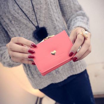 Γυναικείο δερμάτινο πορτοφόλι σε ροζ χρώμα