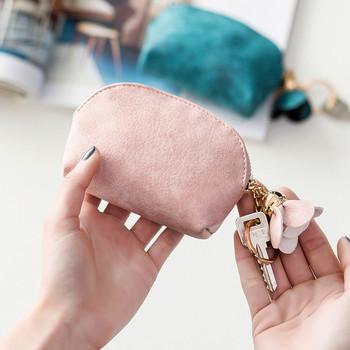 Γυναικείο πορτοφόλι με μεταλλικό αξεσουάρ