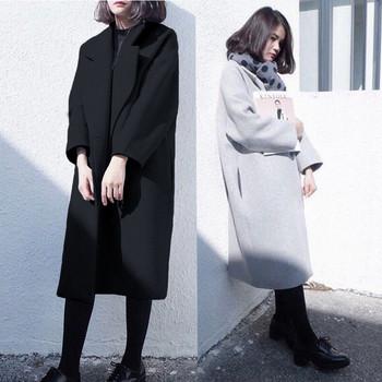 Μακρύ χειμωνιάτικο γυναικείο παλτό με τσέπες σε γκρι και μαύρο χρώμα ... 6d67dbe21b0