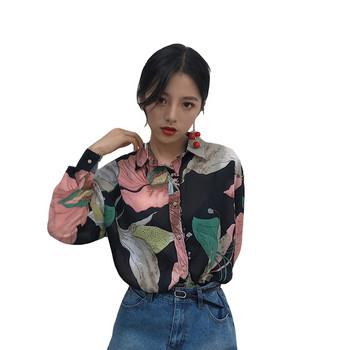 Дамска риза в черен цвят с флорален десен