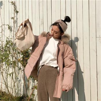 Μοντέρνο γυναικείο μπουφάν με κουκούλα