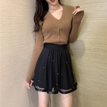 Модерна дамска пола разкроен модел с еластична талия в черен цвят