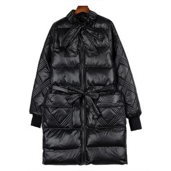 Зимно дамско яке с джобове и връзки в черен и бял цвят