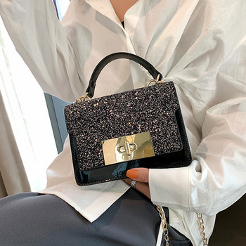 Елегантна дамска чанта от еко кожа с метална закопчалка в два цвята