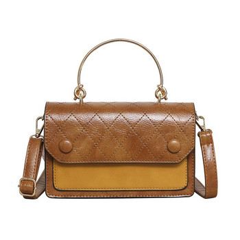 Μοντέρνα γυναικεία τσάντα από οικολογικό δέρμα με μεταλλική λαβή σε πέντε χρώματα