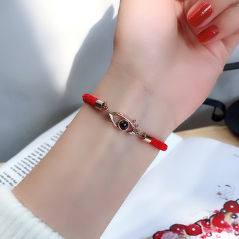 Дамска гривна в червен цвят с камък