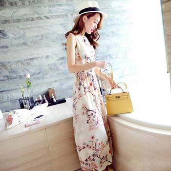 Стилна дамска дълга рокля в флорален мотив