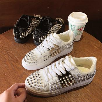 ΝΕΟ μοντέρνα γυναικεία αθλητικά παπούτσια με διακοσμητικά τρουξ σε άσπρο  και μαύρο χρώμα 0b057656885