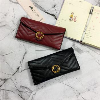 Γυναικείο κομψό πορτοφόλι με μεταλλικό κούμπωμα