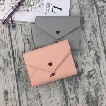 Κομψό γυναικείο μίνι πορτοφόλι με κεντήματα