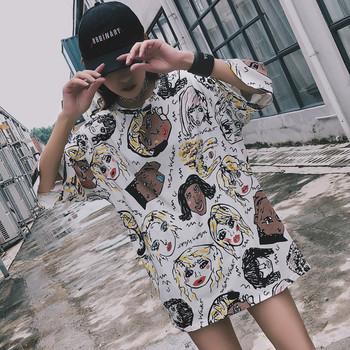 Модерна дамска блуза - широк модел с апликации