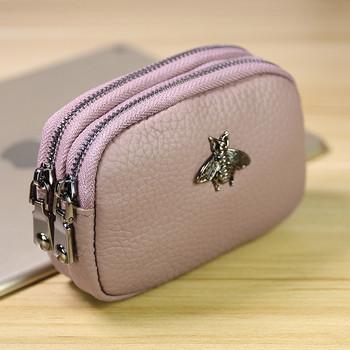 Μοντέρνο έκο δερμάτινο πορτοφόλι  με μεταλλική διακόσμηση και φερμουάρ