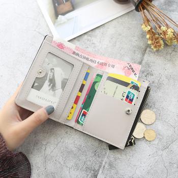 Μοντέρνο γυναικείο πορτοφόλι σε διάφορα χρώματα με τρισδιάστατο στοιχείο