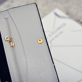 Μοντέρνο γυναικείο πορτοφόλι με εφαρμογή και φερμουάρ