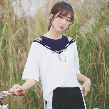 7d9d7e5991bb Κομψή μπλούζα κυρία με κοντό μανίκι και κορδέλα ασύμμετρη μοτίβο ...