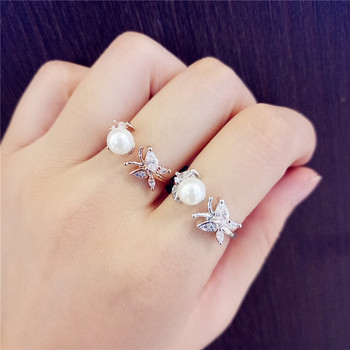 Стилен дамски пръстен с декорация перли и камъни в два цвята