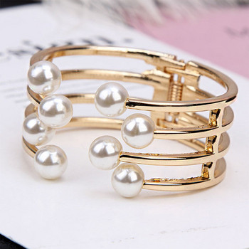 Дамска гривна с елемент перли в златист и сребрист цвят