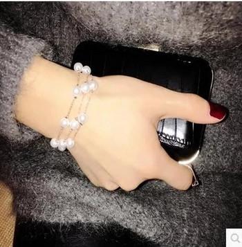 Елегантна дамска гривна с елемент перли