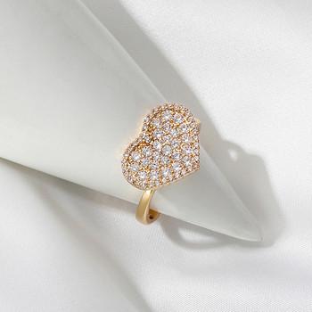 Дамски регулируем пръстен в златист цвят с камъни
