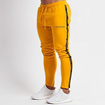 Модерен мъжки спортен панталон в черен и жълт цвят