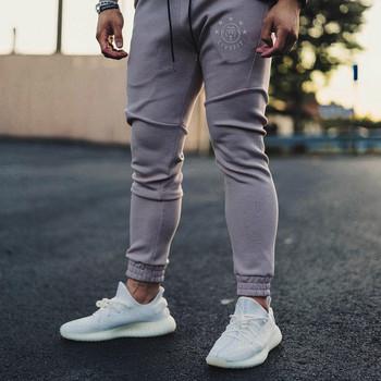 Спортно-ежедневен мъжки панталон в три цвята с апликация