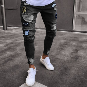 Стилни мъжки дънки в три цвята с разкъсани мотиви и емблеми