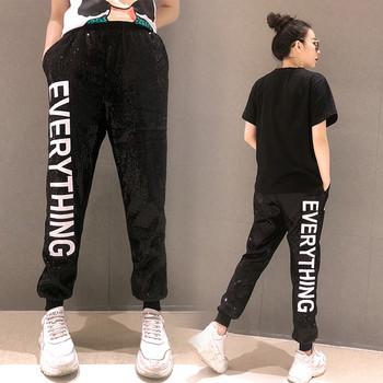 2086e56e314 Модерен дамски панталон с пайети в черен цвят с надпис - Badu.bg ...