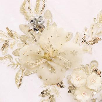 Κομψό γυναικείο σετ τζιν  με λουλούδια με τρισδιάστατα στοιχεία