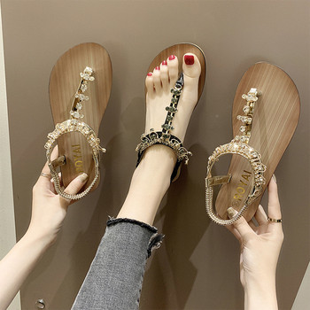 Μοντέρνα γυναικεία σανδάλια με πέτρες σε μαύρο και χρυσό χρώμα