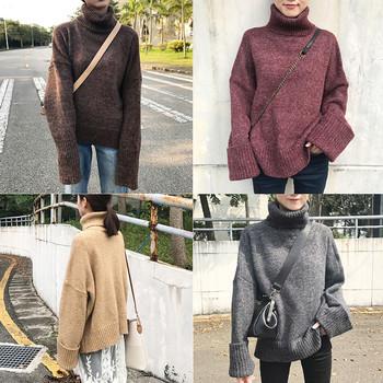 Топъл дамски пуловер в широк модел с поло яка