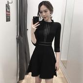 Елегантна дамска рокля с 3/4 ръкави,леко разкроена в черен цвят