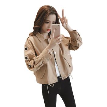 Κομψό σακάκι για κυρίες με μεταλλικά δαχτυλίδια στα μανίκια σε δύο χρώματα