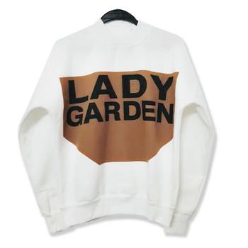 Модерен дамски пуловер с щампа и надпис в широк модел
