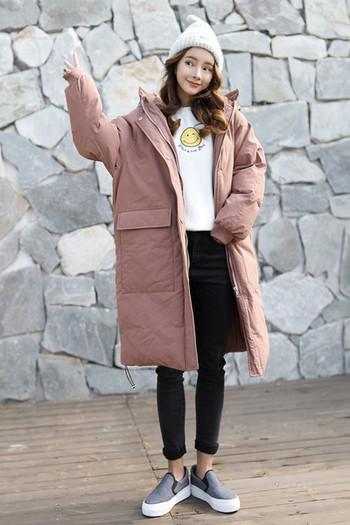 Зимна дълга дамска грейка - актуален модел с големи джобове и качулка