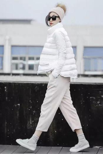Широко зимно дамско яке в бял цвят