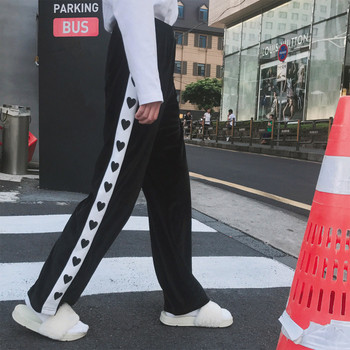 Актуален спортен дамски панталон в широк модел, в розов и черен цвят