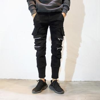 Мъжки спортен панталон в черен цвят с елемент ципове