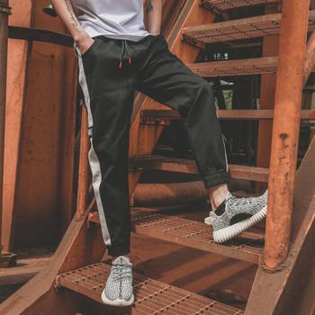 Мъжки спортен панталон с джобове, връзки и цветен кант