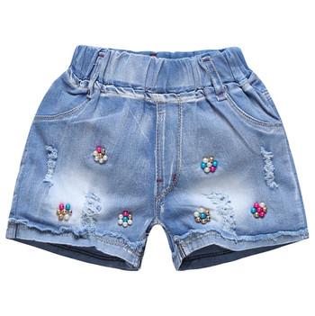 3e62ecdbcde Παιδικά σορτς τζιν για κορίτσια με διακοσμητικές χάντρες, κεντήματα και  εκτύπωση