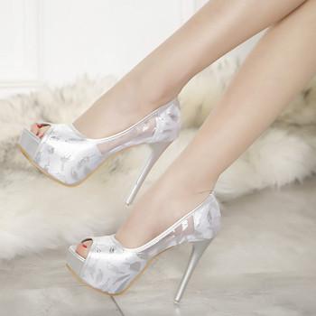 Γυναικεία κομψά παπούτσια σε ψηλό τακούνι σε μαύρο και άσπρο χρώμα ... 1dbcb7e7093