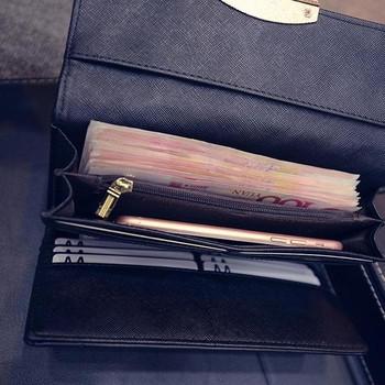 Κομψό γυναικείο πορτοφόλι σε χρυσό και μαύρο χρώμα