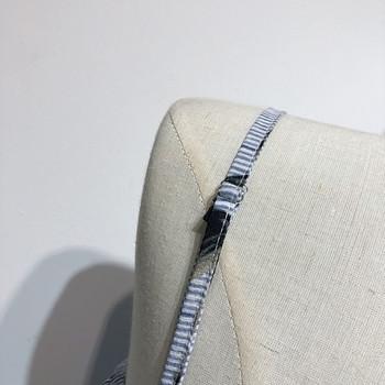 Стилен летен гащеризон с тънки презрамки и отворен мотив, във флорален десен