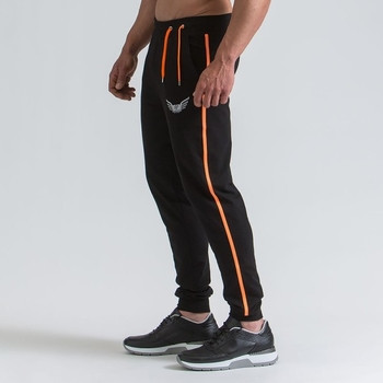 Спортен мъжки анцуг със цветен кант в два цвята