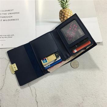 Μοντέρνο γυναικείο πορτοφόλι σε διάφορα χρώματα με μεταλλικά στοιχεία