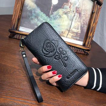 Κομψό γυναικείο πορτοφόλι με φερμουάρ και φυτικά μοτίβα