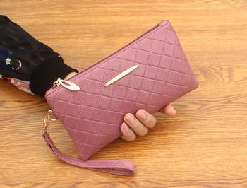 Μεγάλο γυναικείο πορτοφόλι με μεταλλικό στοιχείο σε διάφορα χρώματα