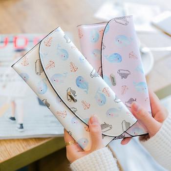 Μεγάλο γυναικείο πορτοφόλι με εφαρμογές και μεταλλικό κούμπωμα από οικολογικό δέρμα